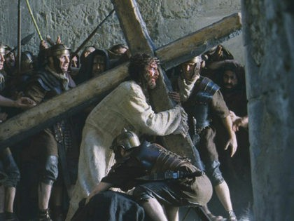 """Actor Jim Caviezel portrays Jesus carrying the Cross in a scene from the new film """"The Passion of The Christ"""" in this undated publicity photograph. The film, produced and directed by actor Mel Gibson, is a vivid depiction of the last twelve hours of the life of Jesus Christ. The …"""