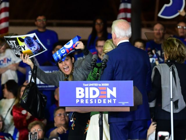 Democratic presidential hopeful former Vice President Joe Biden and his wife Jill watch as a dairy protester is apprehended as Biden addresses supporters at a Super Tuesday event in Los Angeles on March 3, 2020. (Photo by Frederic J. BROWN / AFP) (Photo by FREDERIC J. BROWN/AFP via Getty Images)