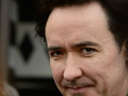 Actor John Cusack receives a star on the Hollywood Walk of Fame in Hollywood, California on April 24, 2012. The ceremony comes three days before the release of Cusack's latest film, ``The Raven.'' AFP PHOTO/ROBYN BECK (Photo credit should read ROBYN BECK/AFP via Getty Images)