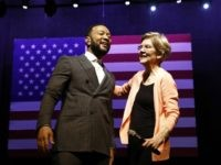 Democratic presidential candidate Sen. Elizabeth Warren, D-Mass., embraces performer John Legend during a campaign event, Wednesday, Feb. 26, 2020, at Charleston Music Hall in Charleston, S.C. (AP Photo/Patrick Semansky)