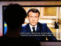 French President Emmanuel Macron is seen on a television screen as he speaks during a televised address to the nation on the outbreak of COVID-19, caused by the novel coronavirus, on March 16, 2020, in Paris. - The French president addresses the nation, with many expecting him to unveil more …