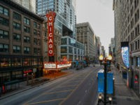 Closed Chicago Theatre is seen in Chicago, Illinois, on March 21, 2020. - Almost one billion people were confined to their homes worldwide on March 21 as the global coronavirus death toll topped 12,000 and US states rolled out stay-at-home measures already imposed across swathes of Europe. More than a …
