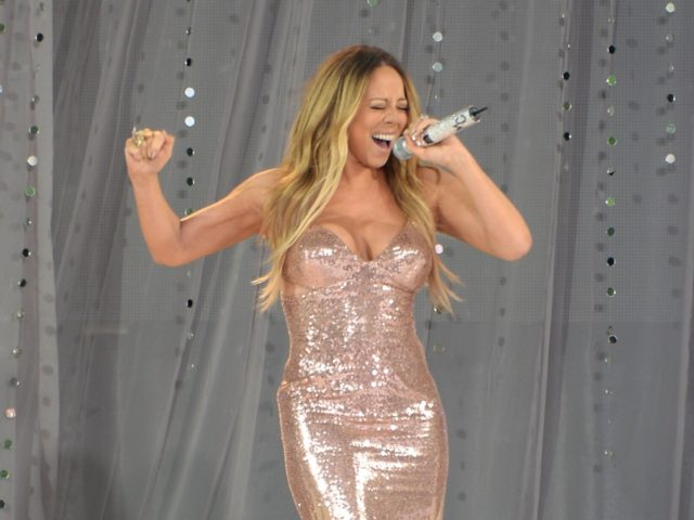 "NEW YORK, NY - MAY 24: Singer Mariah Carey performs on ABC's ""Good Morning America"" at Rumsey Playfield on May 24, 2013 in New York City. (Photo by Andrew H. Walker/Getty Images)"
