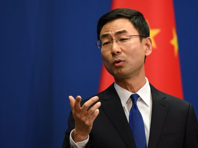 Chinese Foreign Ministry spokesman Geng Shuang speaks during the daily press briefing in Beijing on March 18, 2020. - China on March 18 announced it would expel American journalists from three major US newspapers in one of the communist government's biggest crackdowns on the foreign press, escalating a bitter row …