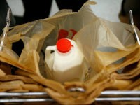 WASHINGTON - AUGUST 20: A half gallon of milk sits in a plastic bag at a Safeway grocery store August 20, 2007 in Washington, DC. The U.S. Labor Department released inflation data showing that U.S. food prices rose by 4.2 percent for the 12 months ending in July. According to …