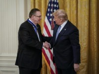 WASHINGTON, DC - MARCH 10: U.S. President Donald Trump (R) shakes hands with retired four-star Army general Jack Keane after presenting him with the Presidential Medal of Freedom to during a ceremony in the East Room of the White House March 10, 2020 in Washington, DC. Gen. Keane currently works …