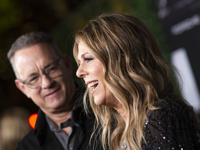 "Actors Tom Hanks (L) and his wief actress/singer Rita Wilson attend ""JONI 75: A Birthday Celebration"" Live at the Dorothy Chandler Pavilion in Los Angeles on November 7, 2018. - Two All-Star Concerts Dedicated to Joni Mitchell on Her 75th Birthday presented by The Music Center. (Photo by VALERIE MACON …"