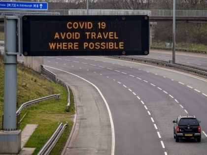 GLASGOW, SCOTLAND - MARCH 24: A sign on the M8 motorway advises motorists to avoid travel where possible on March 24, 2020 in Glasgow, Scotland. First Minister of Scotland Nicola Sturgeon along with British Prime Minister, Boris Johnson, announced strict lockdown measures last night urging people to stay at home …