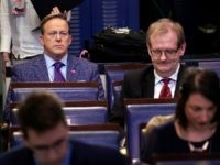 Former White House press secretary Sean Spicer and reporter for Newsmax, top left, listens during a coronavirus task force briefing at the White House, Friday, March 20, 2020, in Washington. (AP Photo/Evan Vucci)