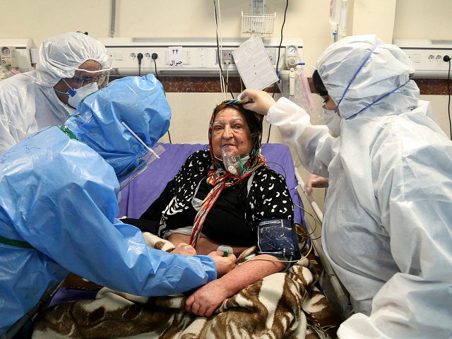 Medics treat a patient infected with the new coronavirus, at a hospital in Tehran, Iran, Sunday, March 8, 2020. With the approaching Persian New Year, known as Nowruz, officials kept up pressure on people not to travel and to stay home. Health Ministry spokesman Kianoush Jahanpour, who gave Iran's new …