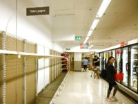 Shelves are empty of toilet rolls in a supermarket in Sydney on March 4, 2020. - Australia's biggest supermarket announced a limit on hand sanitisers and toilet paper purchases after the global spread of coronavirus sparked a spate of panic buying Down Under. (Photo by PETER PARKS / AFP) (Photo …