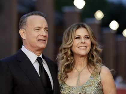 "FILE - In this Thursday, Oct. 13, 2016, file photo, Actor Tom Hanks, left, flanked by his wife Rita Wilson, arrives to receive a lifetime achievement at the Rome Film Festival, in Rome. Ever since her husband, Hanks, appeared on ""Saturday Night Live"" as the strange man in the pumpkin …"
