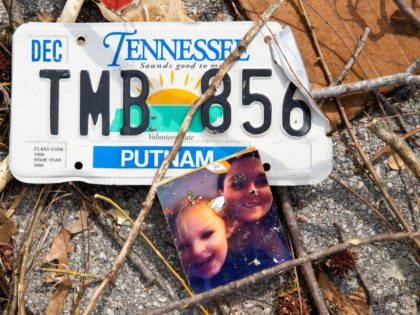 COOKEVILLE, TN - MARCH 03: Detail view of a family photograph and license plate in debris near an apartment complex on March 3, 2020 in Cookeville, Tennessee. A tornado passed through the Nashville area just after midnight leaving a wake of damage in its path including 22 people dead, at …