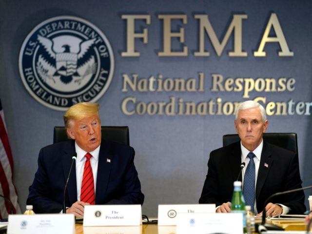 WASHINGTON, DC - MARCH 19: U.S. President Donald Trump (L) and Vice President Mike Pence attend a teleconference with governors at the Federal Emergency Management Agency headquarters on March 19, 2020 in Washington, DC. With Americans testing positive from coronavirus rising President Trump is asking Congress for $1 trillion aid …