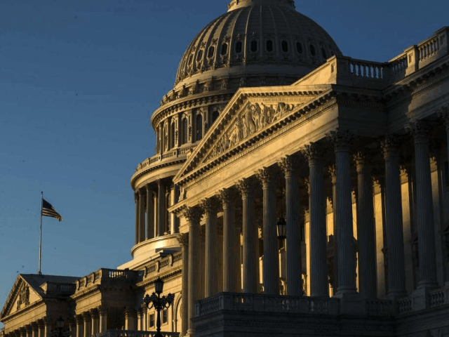 In this Dec. 18, 2019, file photo the U.S. Capitol building is illuminated by the rising sun on Capitol Hill in Washington. Congress is shutting the Capitol and all House and Senate office buildings to the public until April in reaction to the spread of the coronavirus.