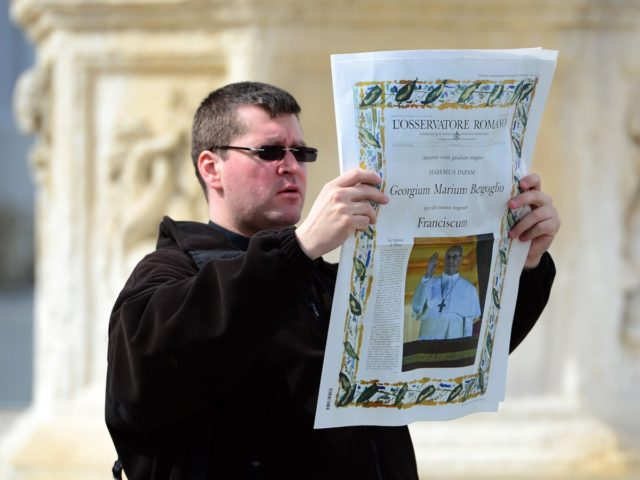VATICAN CITY, VATICAN - MARCH 14: A man holds up a copy of the L'Osservatore Romano in St Peters square on March 14, 2013 in Vatican City, Vatican. A day after thousands gathered in St Peter's Square to watch the announcement of the first ever Latin American Pontiff it has …