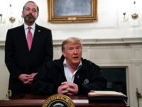 Secretary of Health and Human Services Alex Azar listens as President Donald Trump talks to reporters during a signing of a spending bill to combat the coronavirus, at the White House, Friday, March 6, 2020, in Washington. (AP Photo/Evan Vucci)