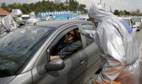Iran warns of lengthy 'new way of life' as virus deaths rise