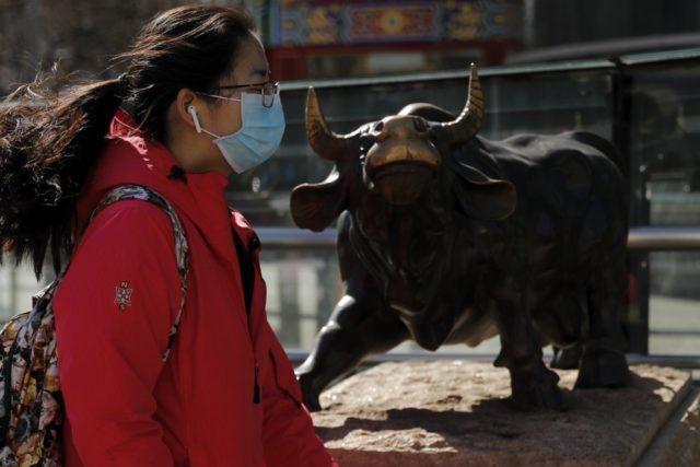 Global markets pick up after plunge on virus, oil