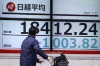 Global stocks dive on pandemic impact, US travel ban