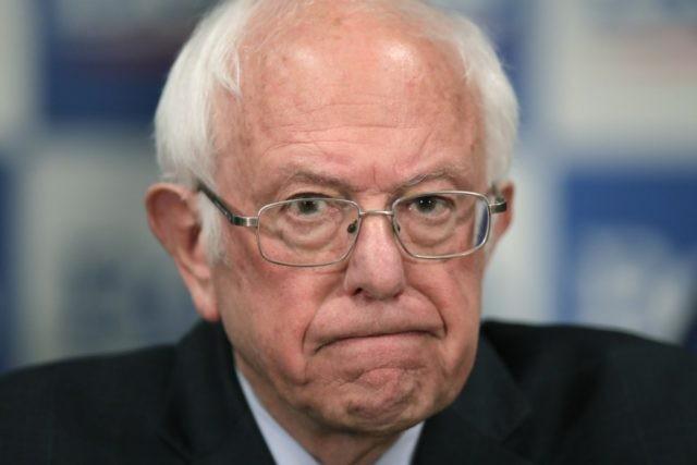 Democratic presidential candidate, Sen. Bernie Sanders, I-Vt., speaks to reporters about coronavirus Thursday March 12, 2020, in Burlington, Vt. (AP Photo/Charles Krupa)