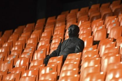 A statue representing a former fan is pictured ahead of the Champions League round of 16 second leg soccer match between Valencia and Atalanta in Valencia, Spain, Tuesday March 10, 2020. The match is being in an empty stadium because of the coronavirus outbreak. (UEFA via AP)