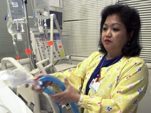 In this May 25, 2005, file photo, Lovely R. Suanino, a respiratory therapist at Newark Beth Israel Medical Center in Newark, N.J., demonstrates setting up a ventilator in the intensive care unit of the hospital. U.S. hospitals bracing for a possible onslaught of coronavirus patients with pneumonia and other breathing …