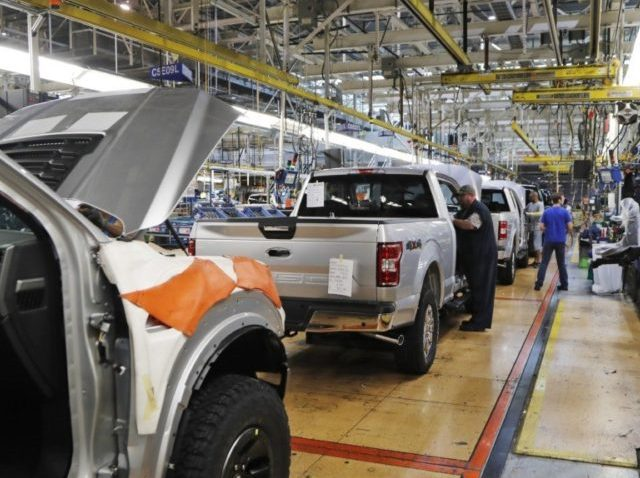 In this Sept. 27, 2018, file photo a United Auto Workers assemblymen work on a 2018 Ford F-150 trucks being assembled at the Ford Rouge assembly plant in Dearborn, Mich. The United Auto Workers union wants Detroit's three automakers to shut down their factories for two weeks to keep its …