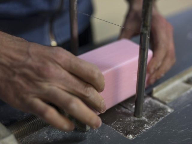 In this photo taken Monday March 16 2020, a factory worker cuts soap into bars at the Licorne soap factory in Marseille, southern France. Amid the rapid outbreak of the new coronavirus across Europe, the hallmark Marseille tradition of soap-making is enjoying a renaissance, as the French public rediscovers this …