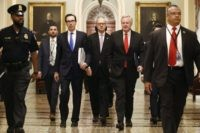 Treasury Secretary Steven Mnuchin, left, accompanied by White House Legislative Affairs Director Eric Ueland and acting White House chief of staff Mark Meadows, walks to the offices of Senate Majority Leader Mitch McConnell of Ky. on Capitol Hill in Washington, Tuesday, March 24, 2020. (AP Photo/Patrick Semansky)