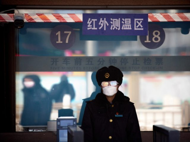 A station worker wears a face mask and goggles as she waits to check passengers' tickets at the Beijing Railway Station in Beijing, Saturday, Feb. 15, 2020. People returning to Beijing will now have to isolate themselves either at home or in a concentrated area for medical observation, said a …