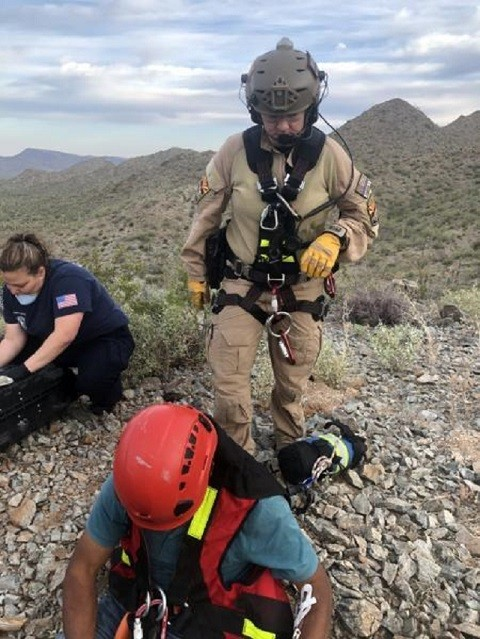 A Border Patrol EMT and a Gila Bend Fire Department EMT treat two illegal aliens and prepared them for airlift to a local hospital. (Photo: U.S. Border Patrol/Tucson Sector)