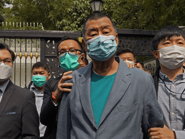 Hong Kong media tycoon Jimmy Lai, center, who founded local newspaper Apple Daily, is arrested by police officers at his home in Hong Kong, Saturday, April 18, 2020. Hong Kong police arrested at least 14 pro-democracy lawmakers and activists on Saturday on charges of joining unlawful protests last year calling …
