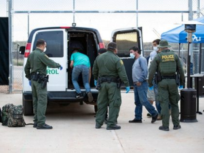 Border Patrol agents apprehend a group of migrants who illegally crossed the border from Mexico. (CBP Photo by Jerry Glaser)