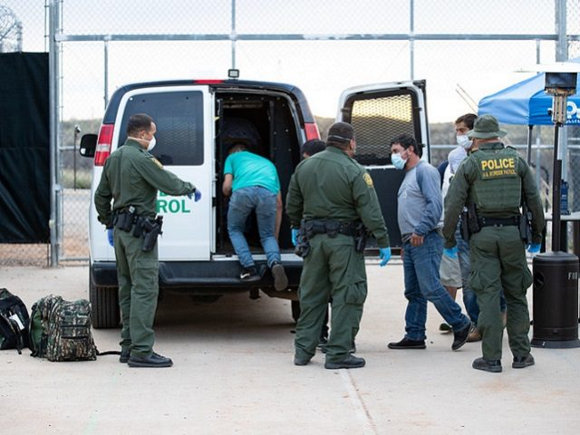 U.S. Border Patrol agents process a group of illegal aliens who crossed the border illegally from Mexico near Sasabe, Arizona on March 22. (Photo: U.S. Border Patrol/Jerry Glaser)
