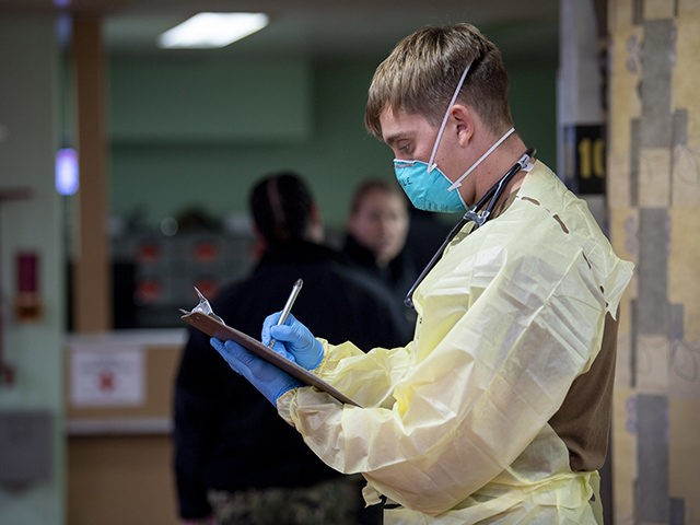 LOS ANGELES (April 1, 2020) Ensign Patrick Coyle, from Tampa, Fla., writes down patient information aboard the hospital ship USNS Mercy (T-AH 19) April 1. Mercy deployed in support of the nation's COVID-19 response efforts, and will serve as a referral hospital for non-COVID-19 patients currently admitted to shore-based hospitals. …