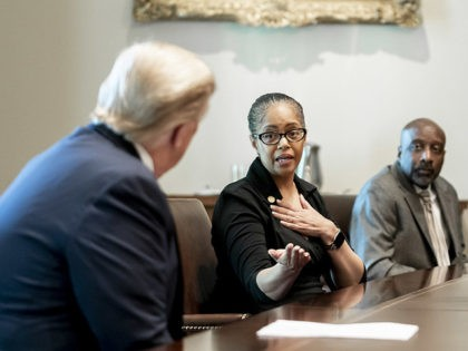 President Donald J. Trump listens as Michigan State Rep. Karen Whitsett talks about her recovery from the COVID-19 Coronavirus, Tuesday, April 14, 2020, in the Cabinet Room of the White House. (Official White House Photo by Andrea Hanks)