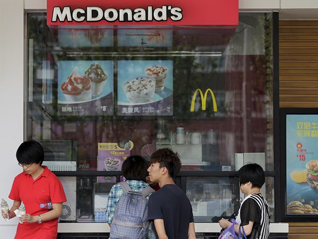 FILE - In this Thursday, April 30, 2015, file photo, customers buy sundae cones at a McDonald's restaurant in Beijing. McDonald's Corp. said Thursday, March 31, 2016, it plans to open 1,500 new restaurants in China, South Korea and Hong Kong as it looks to faster-growing markets to help drive …