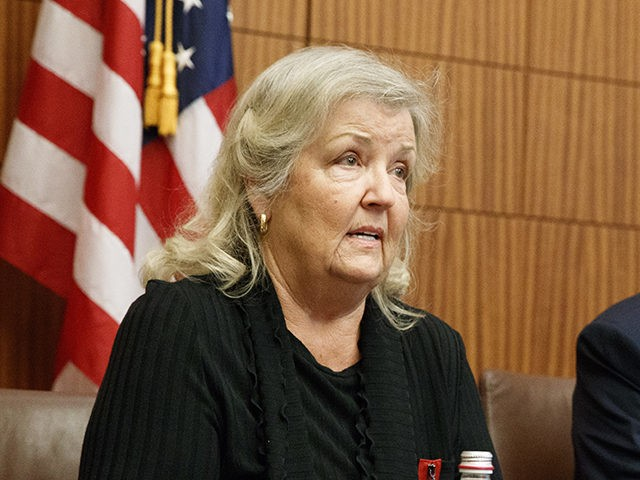 Republican presidential candidate Donald Trump looks on as Juanita Broaddrick, who has accused former President Bill Clinton of sexual assault, speaks before the second presidential debate against democratic presidential candidate Hillary Clinton, Sunday, Oct. 9, 2016, in St. Louis. (AP Photo/ Evan Vucci)