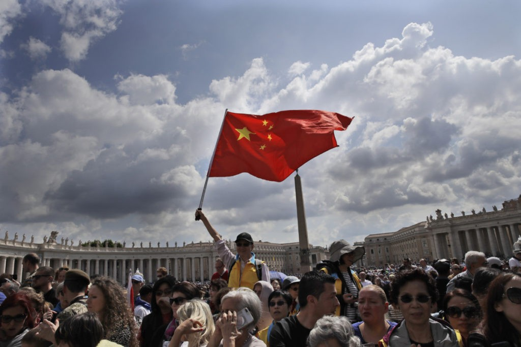 A Chinese faithful waves a flag as he attends Pope Francis weekly general audience in St. Peter's square at the Vatican, Wednesday, May 22, 2019. (AP Photo/Alessandra Tarantino)
