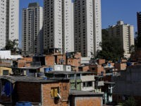 This May 22, 2019 photo shows brick and block brick houses of the sprawling slum neighborhood of Paraisopolis stacked next to the posh Morumbi neighborhood, in Sao Paulo, Brazil. A study released this month by the Getulio Vargas Foundation found that the key measure of income inequality has reached its …