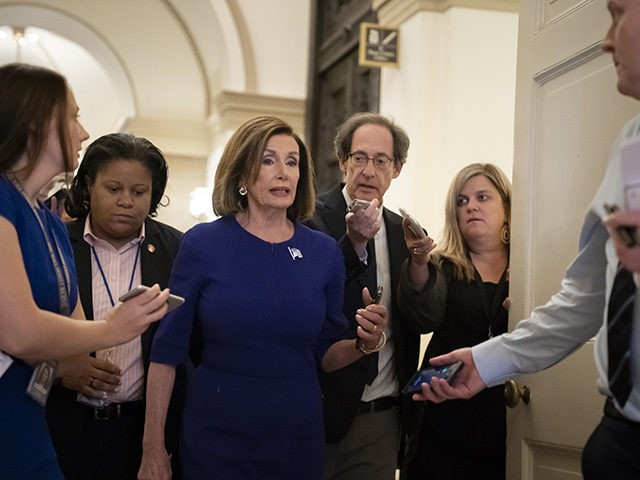Speaker of the House Nancy Pelosi, D-Calif., is questioned by reporters as she departs the Capitol en route to a speaking event in Washington, Tuesday, Sept. 24, 2019. Pelosi will meet with her caucus later as more House Democrats are urging an impeachment inquiry amid reports that President Donald Trump …