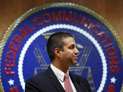 FILE - In this Dec. 14, 2017, file photo, after a meeting voting to end net neutrality, Federal Communications Commission (FCC) Chairman Ajit Pai smiles while listening to a question from a reporter in Washington. A federal court is ruling that the FCC had the right to dump net-neutrality rules, …