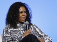 Former U.S. fist lady Michelle Obama speaks during an event for Obama Foundation in Kuala Lumpur, Malaysia, Thursday, Dec. 12, 2019. Obama and actress Julia Roberts attend inaugural Gathering of Rising Leaders in the Asia Pacific organized by the Obama Foundation. (AP Photo/Vincent Thian)