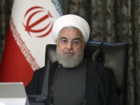 In this photo released by the official website of the Office of the Iranian Presidency, President Hassan Rouhani attends a cabinet meeting in Tehran, Iran, Wednesday, March 18, 2020. Iran has been the hardest hit country by the new coronavirus in the Middle East. For most people, the new coronavirus …