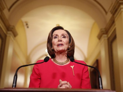 House Speaker Nancy Pelosi of Calif. speaks outside her office on Capitol Hill, Monday, March 23, 2020. (AP Photo/Andrew Harnik, Pool)