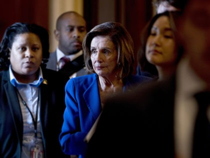 House Speaker Nancy Pelosi of Calif., walks to her office after signing the Coronavirus Aid, Relief, and Economic Security (CARES) Act after it passed in the House on Capitol Hill, Friday, March 27, 2020, in Washington. The $2.2 trillion package will head to head to President Donald Trump for his …