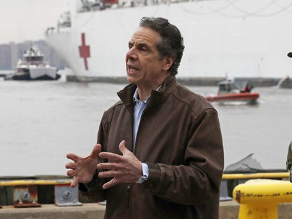 New York Go. Andrew Cuomo, left, speaks as he stands beside Rear Adm. John B. Mustin after the arrival of the USNS Comfort, a naval hospital ship with a 1,000 bed-capacity, Monday, March 30, 2020, at Pier 90 in New York. The ship will be used to treat New Yorkers …