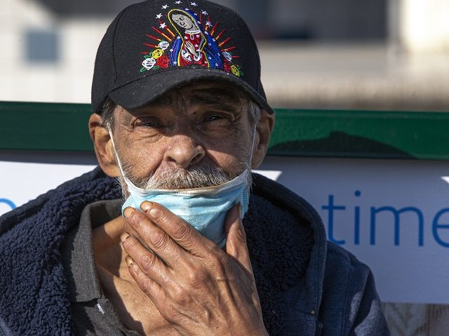Jose Villanueva, 77, originally from Durango, Mexico, adjusts his face mask after eating in the Boyle Heights area of Los Angeles on Wednesday, April 1, 2020. Los Angeles Mayor Eric Garcetti has recommended that the city's 4 million people wear masks when going outside amid the spreading coronavirus. Garcetti on …