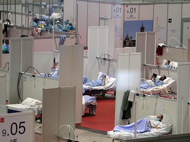 A view of a temporary field hospital set at Ifema convention and exhibition of in Madrid, Spain, Thursday, April 2, 2020. The new coronavirus causes mild or moderate symptoms for most people, but for some, especially older adults and people with existing health problems, it can cause more severe illness …